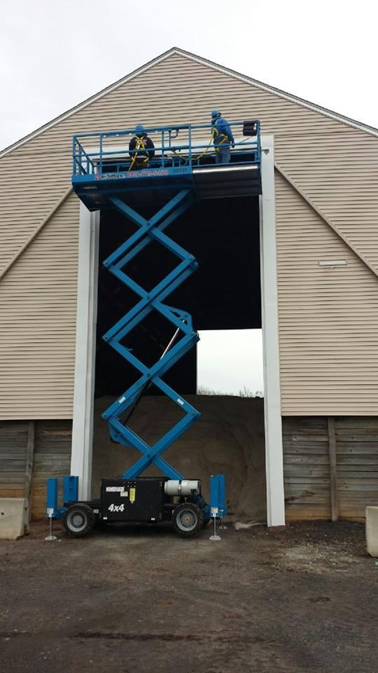 Overhead door installation in progress